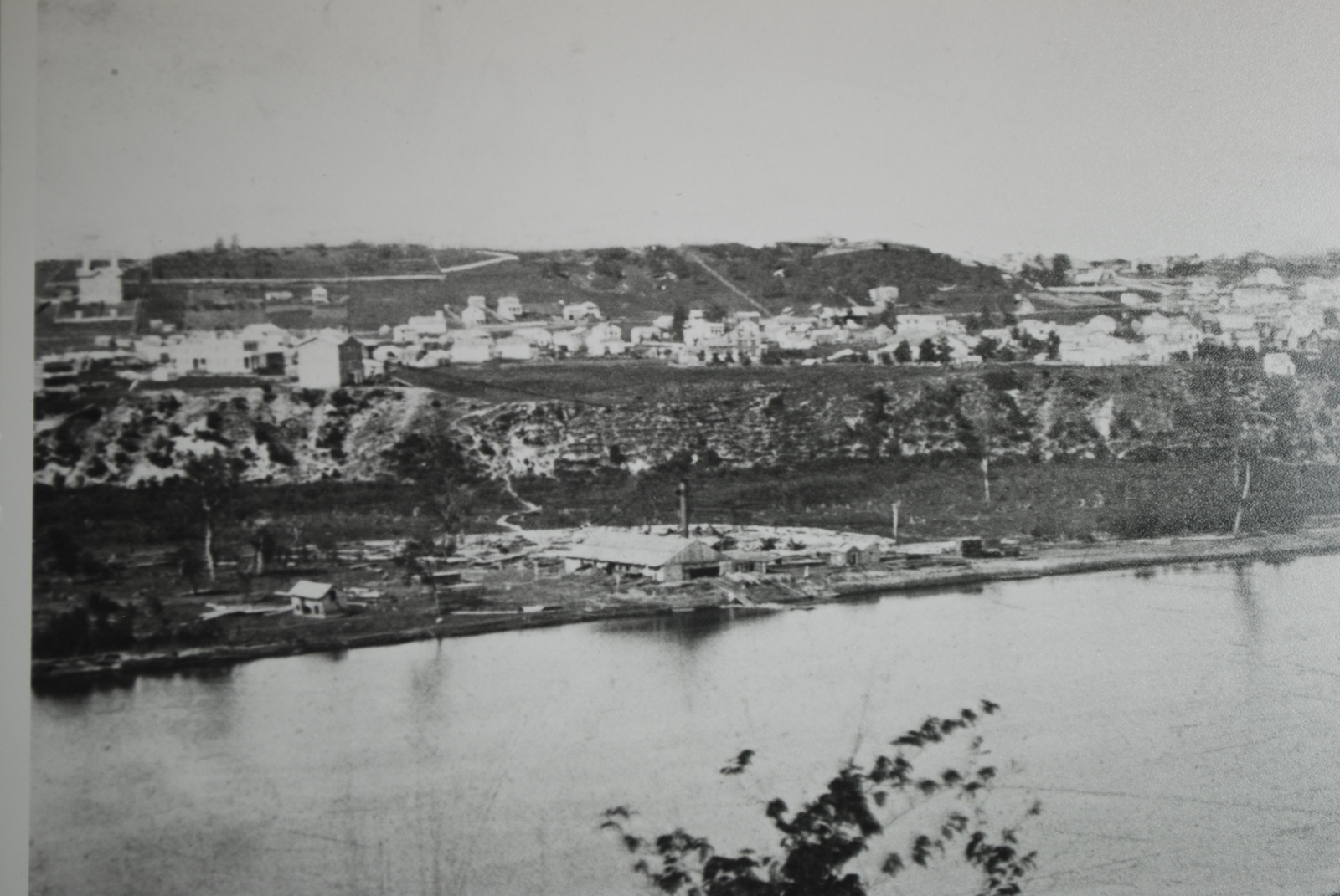 Uppertown, St. Paul in 1860. The Waldman House is just beyond the left edge.  William's Ferry is in the foreground; the St. Paul College (now Little Sisters of the Poor) is the prominent building on the bluff above.