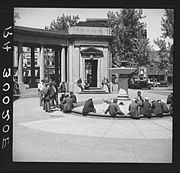Men sitting by the fountain at Gateway Park, 1937