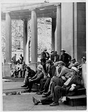 Unemployed men sitting on the steps of the Gateway Center Building, as photographed by the Minneapolis Tribune in 1950. Minneapolis Collection, Hennepin County Library Special Collections.
